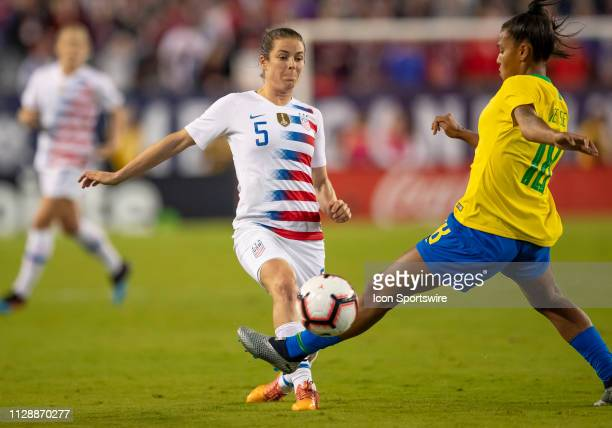 Unites States defender Kelley O'Hara challenges Brazil midfielder Geyse during the She Believes Cup match between the USA and Brazil on March 5 2019...