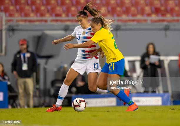 Unites States forward Alex Morgan and Brazil midfielder Monica during the She Believes Cup match between the USA and Brazil on March 5 2019 at...