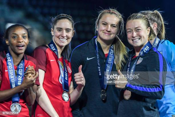 Unites States midfielder Morgan Brian Unites States midfielder Lindsey Horan and Unites States defender Emily Sonnett give a thumbs up after winning...