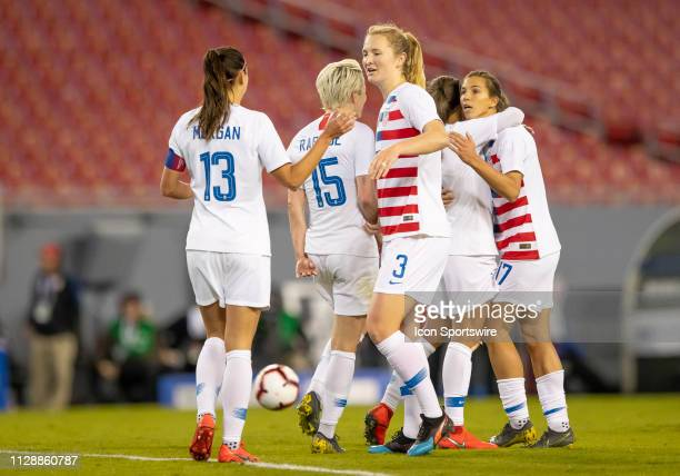 Unites States midfielder Samantha Mewis celebrates with Unites States forward Alex Morgan after Unites States Tobin Heath scores the Unites States...