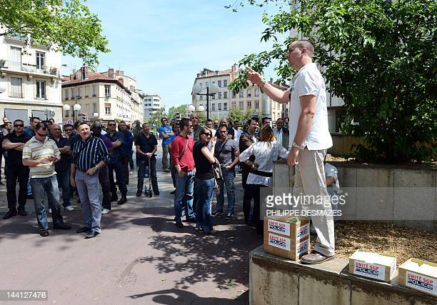Unité-FO labour Police union representative speaks as French policemen demonstrate, on May 10 in Lyon, to protest charges laid against a colleague...