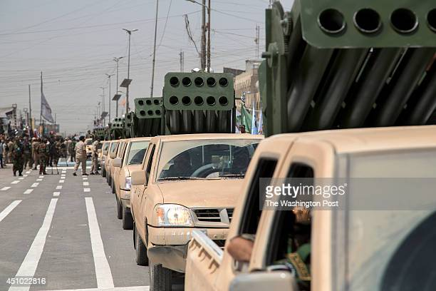 Units of Moqtada Sadr's militia parade with truck mounted rocket launchers down a main street of the Shi'a stronghold of Sadr City June 21 2014 in...