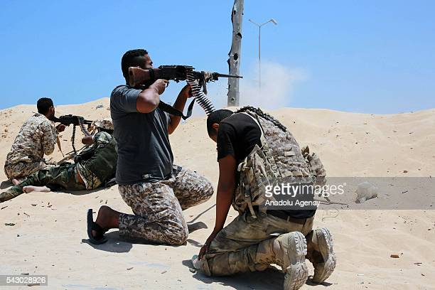 Unity government forces attack DAESH militants with heavy and light weapons in Sirte Libya on June 25 2016