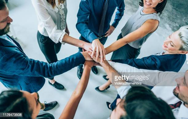 unity is their greatest advantage - hands clasped stock pictures, royalty-free photos & images