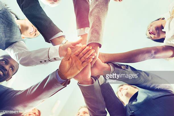 unity of successful multi-ethnic business people holding hands - honesty stock pictures, royalty-free photos & images