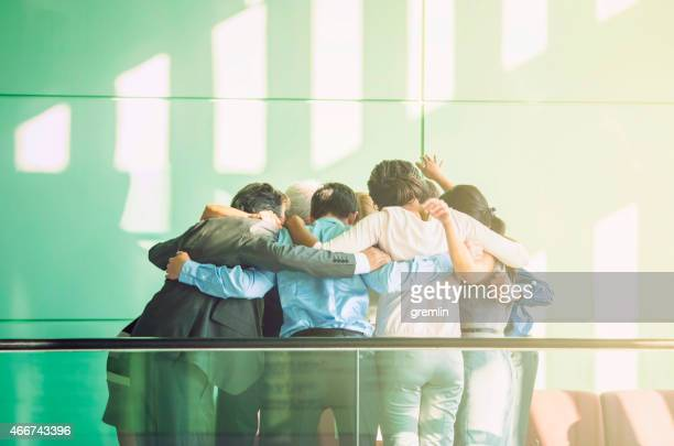 unity of successful multi-ethnic business people holding hands - chanting stock pictures, royalty-free photos & images