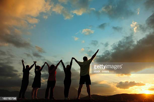 unity - hands clasped stock pictures, royalty-free photos & images
