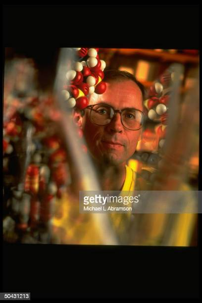 IN Univ microbiologist Dr Norman Pace amidst RNA molecule model in lab re hot world theory of origins of life