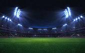 universal grass stadium illuminated by spotlights and empty green grass playground