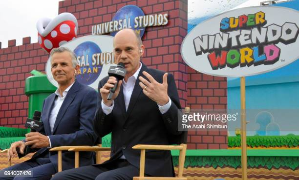 Universal Parks Resorts President of the design and development group Mark Woodbury and Universal Studios Japan CEO and president JeanLouis Bonnier...