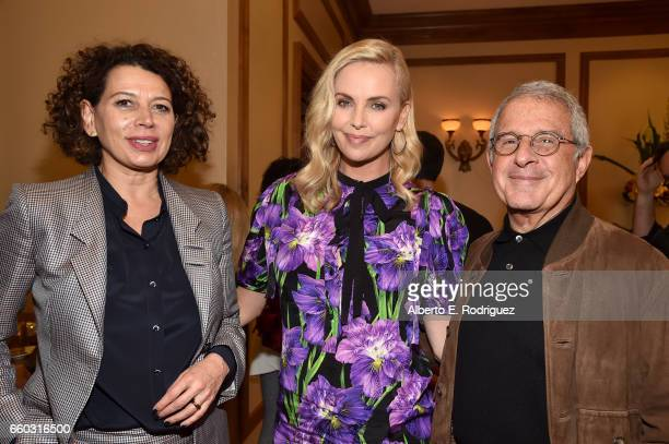 Universal Pictures Chairman Donna Langley actor Charlize Theron and NBC Universal Vice Chairman Ronald Meyer at CinemaCon 2017 Focus Features...