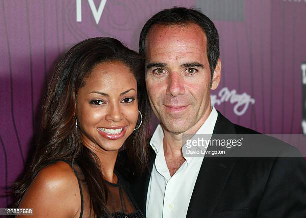 Universal Republic Records president/CEO Monte Lipman and wife Angelina Lipman attend Cash Money Records' Lil Wayne album release party for Tha...