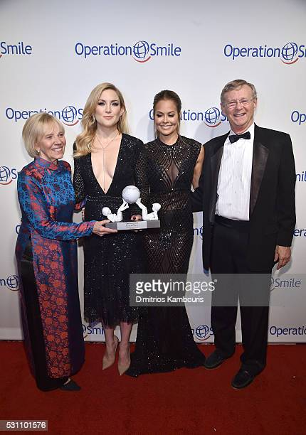 Universal Smile Award Recipient actress Kate Hudson and TV personality Brooke BurkeCharvet pose for a photo together with Operation Smile CoFounders...