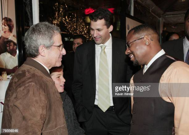 Universal's Ron Meyer his son Eli producer Scott Stuber and actor Martin Lawrence arrive at the premiere of Universal's Welcome Home Roscoe Jenkins...