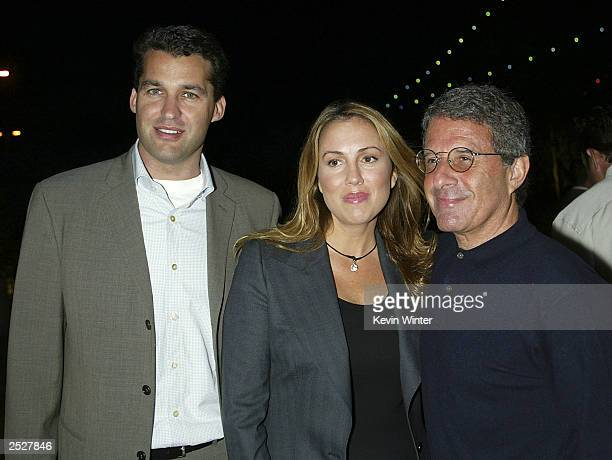 Universal's Scott Stuber Mary Parent and Ron Meyer pose at the premiere of The Rundown at the Universal Amphitheatre on September 22 2003 in Los...