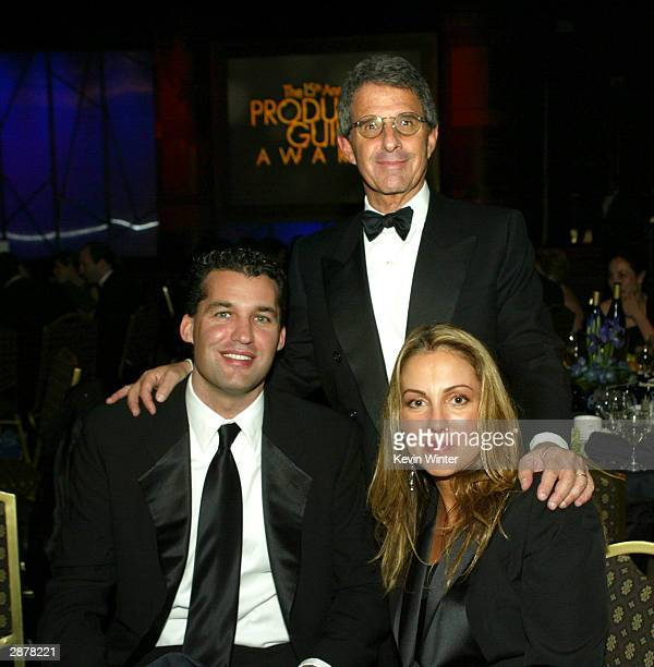 Universal's Scott Stuber Ron Meyer and Mary Parent pose at the 15th Annual Producers Guild Awards on January 17 2004 at the Century Plaza Hotel in...