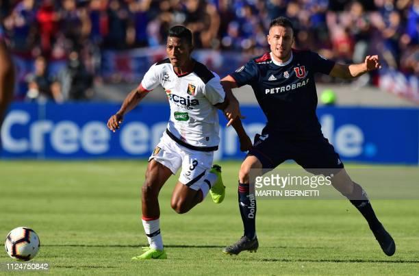 Universidad de Chile Angelo Henriquez vies for the ball with Peru's Melgar footballer Alexis Arias during a Copa Libertadores football match at the...