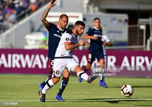 Universidad de Chile Lucas Aveldano vies for the ball with Peru's Melgar footballer Angelo Henriquez during a Copa Libertadores football match at the...