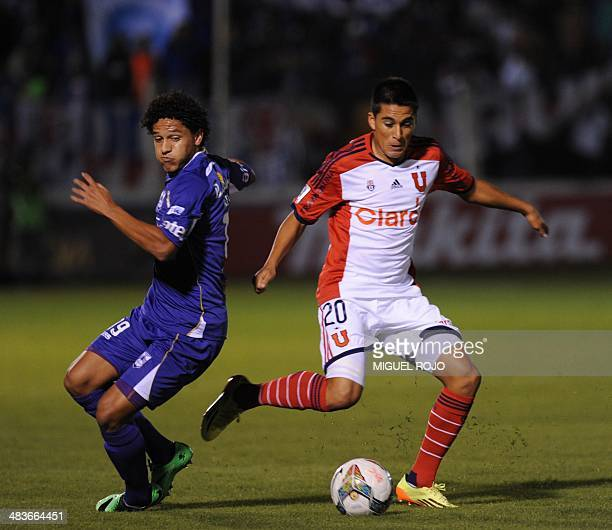 Universidad de Chile's Bryan Cortes vies for the ball with Gedoz of Uruguayan Defensor Sporting during their Libertadores Cup football match at the...