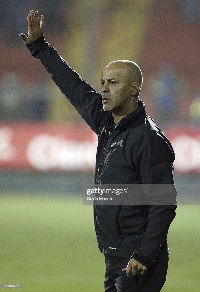 Universidad de Chile's coach Marco Antonio Figueroa gestures during a match between Universidad de Chile and Cobresal as part of the Torneo Apertura 2013 at Santa Laura Stadium on August 09, 2013 in Santiago, Chile.