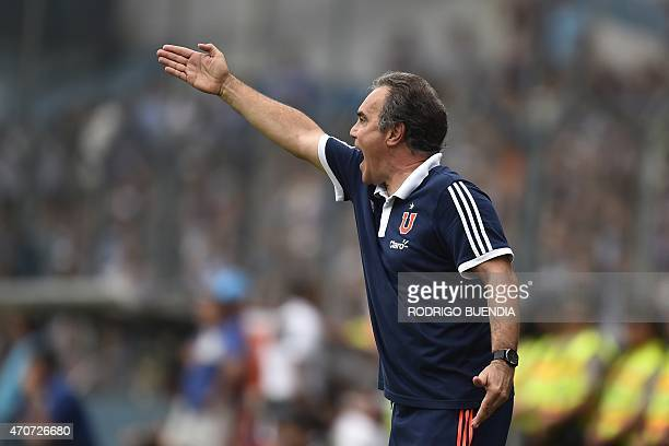 Universidad de Chile's coach Martin Lasarte gestures during their Copa Libertadores football match against Emelec at George Capwell stadium in...