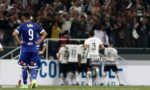 Universidad de Chile's F Mora reacts after Corinthians Rodriguinho scored during their 2017 Sudamericana Cup football match held at the Arena...