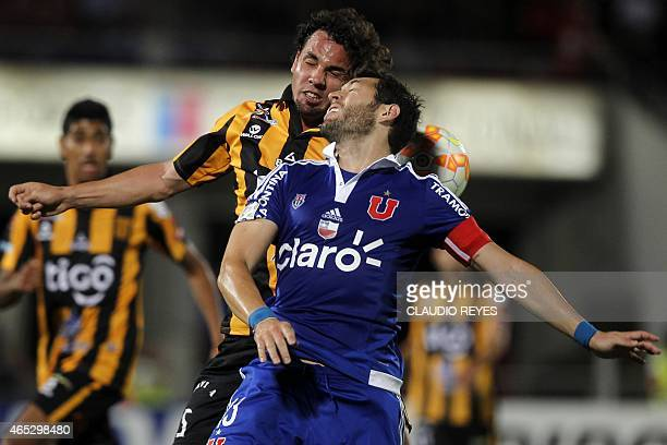 Universidad de Chile's footballer Jose Rojas vies for the ball with Bolivia's The Strongest's Luis Martelli during their Copa Libertadores football...