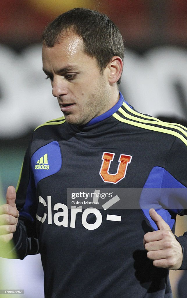 Universidad de Chile's Gustavo Lorenzetti warms up prior a match between Universidad de Chile and Cobresal as part of the Torneo Apertura 2013 at Santa Laura Stadium on August 09, 2013 in Santiago, Chile.