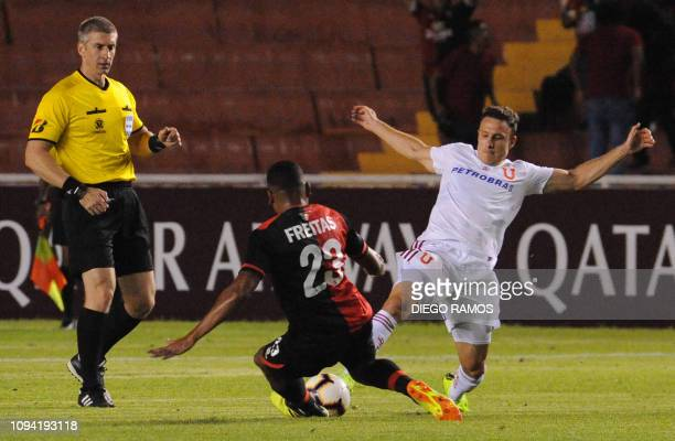 Universidad de Chiles player Angelo Henriquez vies for the ball with Peru's Melgar player Nicolas Freitas during their Copa Libertadores football...