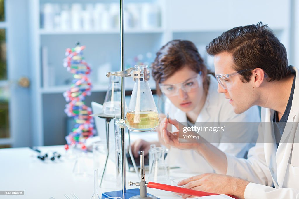 University Chemistry Laboratory Research Students Working in Class Together : Stock Photo