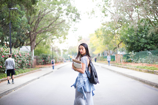 University college student on walking with books - gettyimageskorea