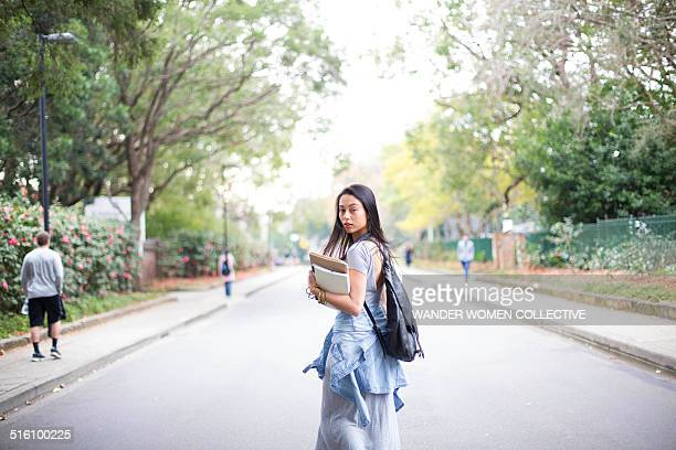 University college student on walking with books