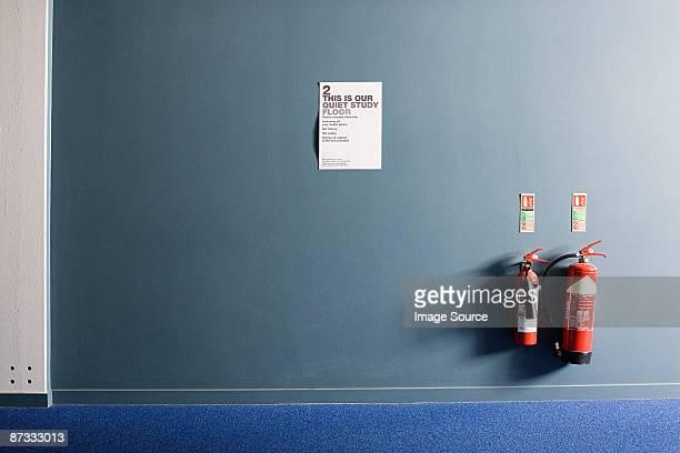 university corridor - fire extinguisher stock photos and pictures