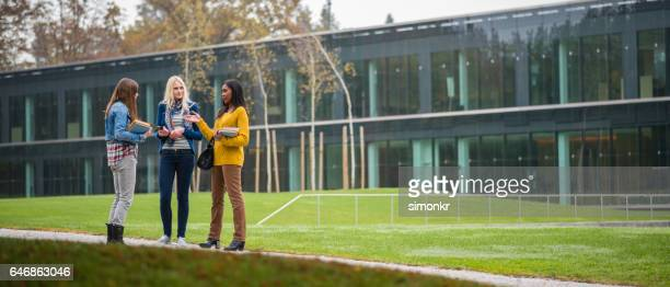 university female students talking - campus stock photos and pictures