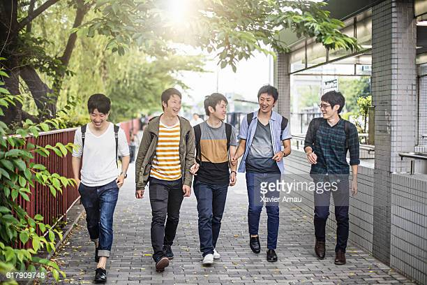 University friends walking on the street