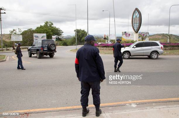 University guards turn cars away following a protest rally by the students in Port Moresby on June 8 2016 Police in Papua New Guinea opened fire on...