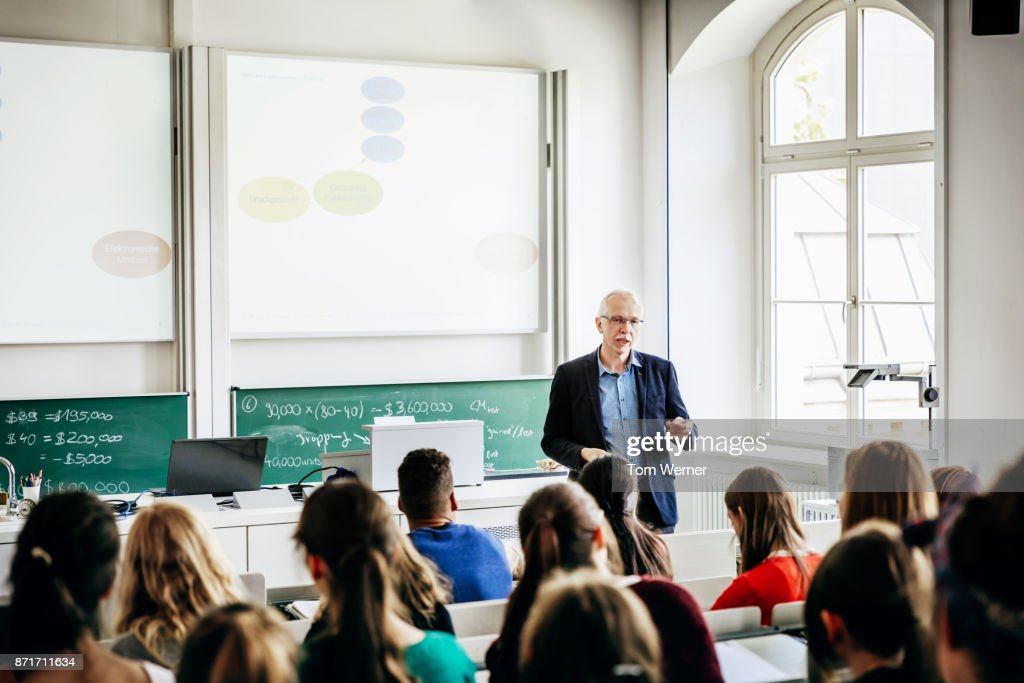 University Lecturer Addressing His Students : Stock Photo
