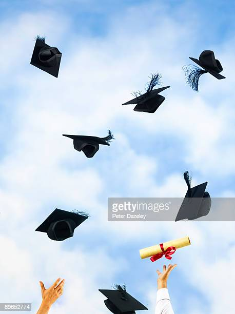 University mortarboards and certificates.
