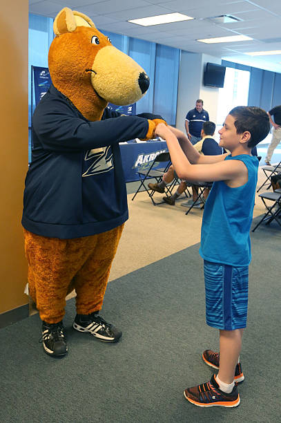 making an impact fifth grader with rare condition signs on with