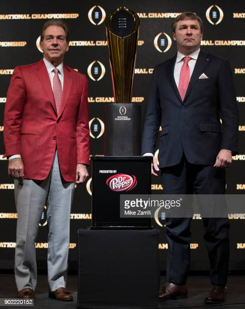 University of Alabama head coach Nick Saban and University of Georgia head coach Kirby Smart stand with the College Football Playoff National...