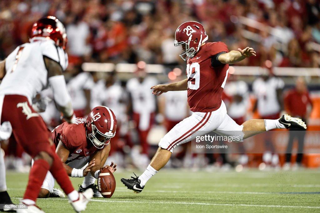 University Of Alabama Kicker Austin Jones Kicks An Extra Point