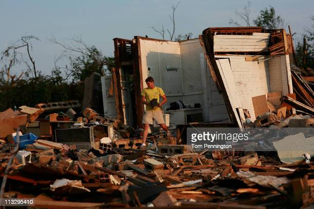 University of Alabama student Clayton Farr gathers his belongings from his destroyed home on April 30, 2011 in Tuscaloosa, Alabama. Alabama, the...