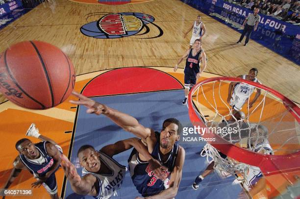 University of Arizona Center Loren Woods attempts to block Duke guard Chris Duhon shot during the NCAA Photos via Getty Images Men's Basketball Final...