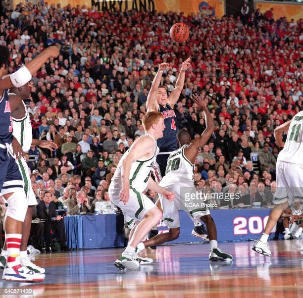 University of Arizona forward Luke Walton makes a pass to a teammate over Michigan State guard/forward Mike Chappell during the Division 1 semifinal...