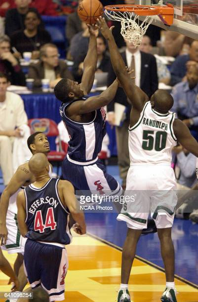 University of Arizona forward Michael Wright goes to the hoop past Michigan State center Zach Randolph during the Division 1 semifinal game of the...