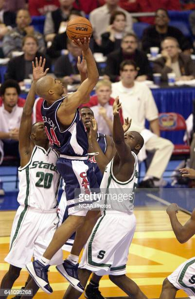University of Arizona forward Richard Jefferson goes up over Michigan State center Zach Randolph and guard/forward Mike Chappell during the Division...