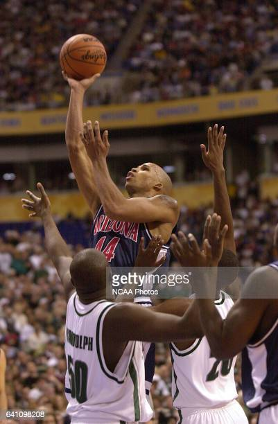 University of Arizona forward Richard Jefferson shoots the ball over Michigan State center Zach Randolph and guard/forward Mike Chappell during the...