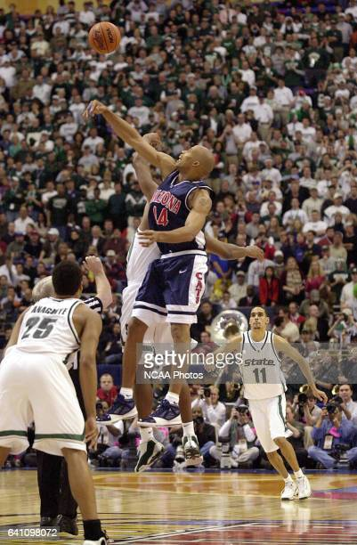 University of Arizona forward Richard Jefferson wins the opening tip off with Michigan State center Zach Randolph during the Division 1 semifinal...