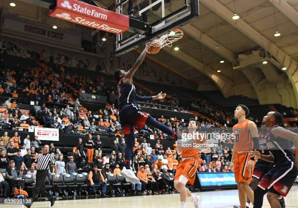 University of Arizona freshman guard Kobi Simmons slam dunks the ball during a PAC-12 Conference basketball game between the Oregon State Beavers and...