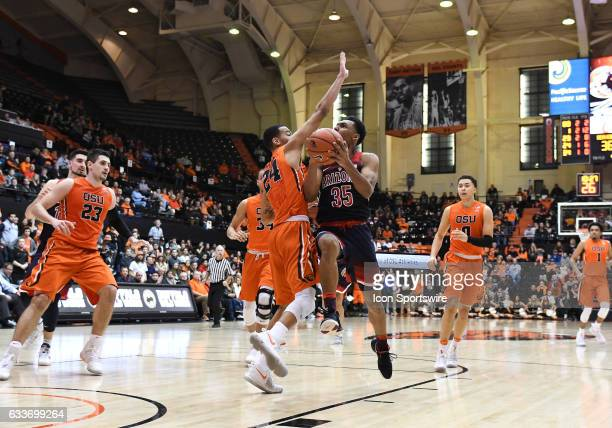 University of Arizona sophomore guard Allonzo Trier shoots the ball while defended by Oregon State University freshman guard Kendal Manuel during a...